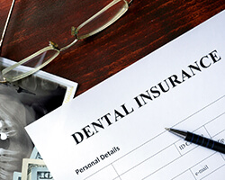 Dental insurance paperwork for the cost of dental implants in Gorham