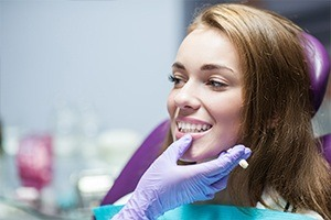 Dentist examining woman's flawless smile