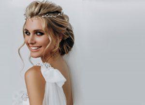 woman smiling wearing wedding dress