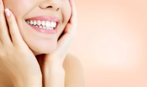woman with beautiful smile from cosmetic dentist in Gorham