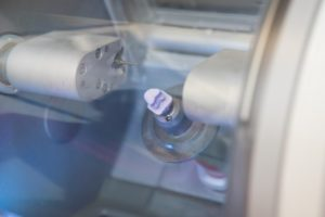 a CEREC crown being crafted in a milling machine