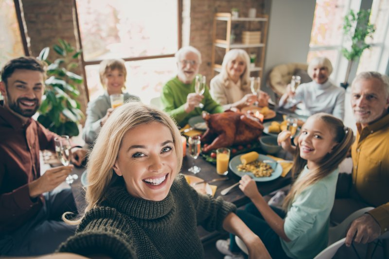 Loved ones smiling before holiday feast