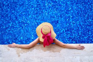 Woman on vacation preventing dental emergencies